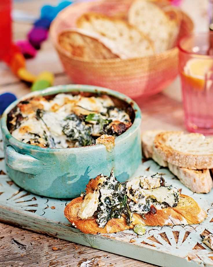 Serve this dip of garlicky spinach and artichokes baked with parmesan and mozzarella for an everyone dig in kind of starter.