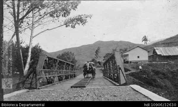 Erich Barth. Coche cruzando el puente sobre el río Aguacatal. Cali 1921.SANTIAGO DE CALI: Biblioteca Departamental Jorge Garces Borrero, 1921. 6 X 10.5.