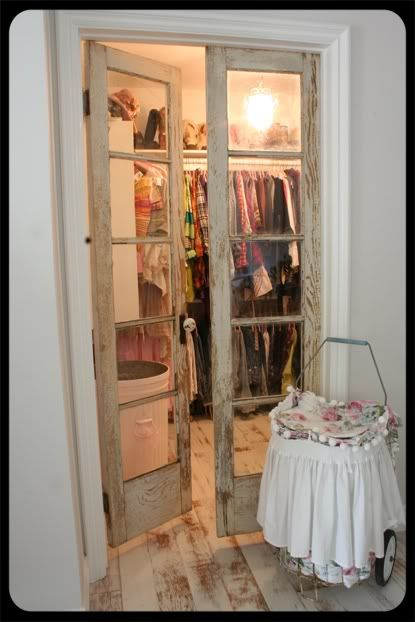 Old doors repurposed for closet doors.