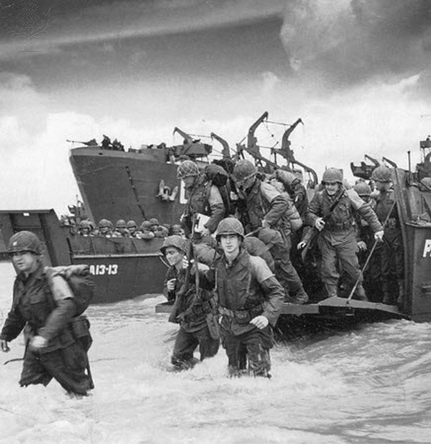 Normandy - Our boys unloading at Omaha Beach. Lost so many that day.