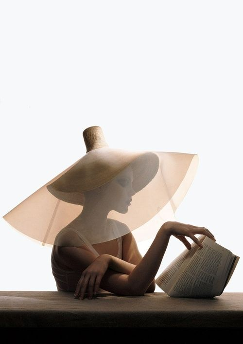 Yohji Yamamoto straw hat with clear plastic overlay. VOGUE, 2004 photo by Irving Penn