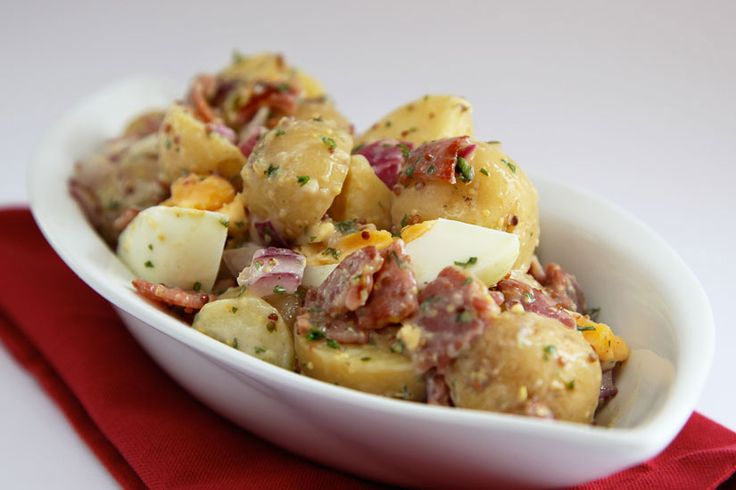 Potato Salad is usually high in fat and calories. Using bacon short cuts and low-fat mayonnaise makes this a tasty, low-fat and low-calorie salad.