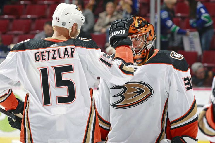 VANCOUVER, BC - JANUARY 2: Ryan Miller #30 of the Anaheim Ducks is congratulated by Ryan Getzlaf #15 after winning their NHL game against the Vancouver Canucks at Rogers Arena January 2, 2018 in Vancouver, British Columbia, Canada. The Anaheim Ducks won 5-0. (Photo by Jeff Vinnick/NHLI via Getty Images)
