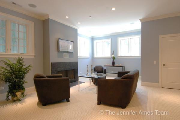 Suzie: Jennifer Ames Realty  Chic basement living room space! Blue gray paint color walls, ...