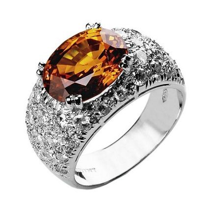 Are you in the mood for a dramatic orange Wow effect? Aral The most classic diamond band shines with a mandarin garnet in it's centre,  handmade in white gold 18 K. Photo Ansuini since 1860