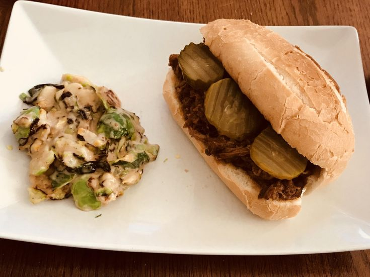 [I ate] Homemade Smoked Pulled Pork on an Amoroso roll with Roasted Brussels Sprout in Balsamic Maple slaw. I decided to make lunch with only items found in the Refrigerator/Freezer and this was the result.
