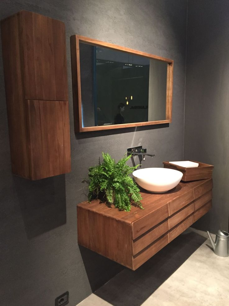 Floating wood vanity with a mid century flair