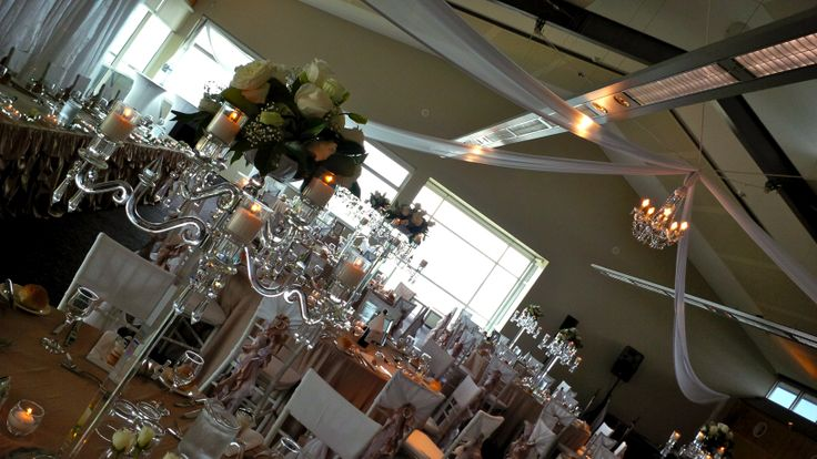 #chandelier #candelabra #freshflowers #ceilingdrapery #tiffanychairs #beige