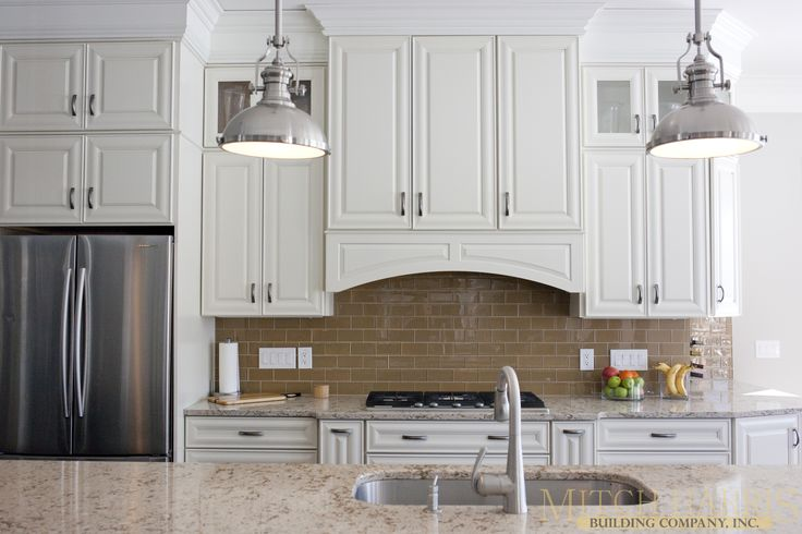 Beautiful modern kitchen with white cabinets cambria for Brighton kitchen cabinets