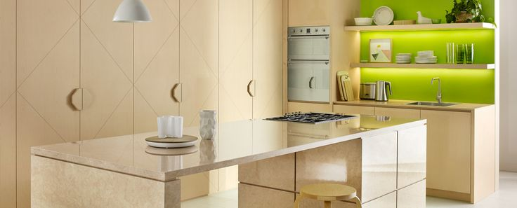 Rear benchtop and cupboards in 'Dansk Maple' with isla nd benchtop in Diamond Gloss 'Lunar Stone'.