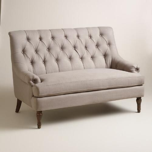 Upholstered in neutral taupe-gray polyester fabric, our love seat is a sophisticated sofa for small spaces. Its wide seat, generously tufted back, tufted arm details and turned legs create a vintage-inspired air in your living area.