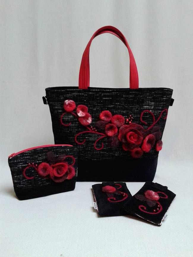 Ez a fekete #Exclusive #táska feltűnő mégis elegáns. A fekete melírozott szövet alapon szinte életre kelnek a mélybordó, pirosas virágok. A gyönyörű rózsát lehelet finom csillogó organza anyaggal kombináltam. Kisebb virágokat nemezeltem és a kacskaringós hímzést apró gyöngyökkel egészítettem ki. A piros fül igazán extravagáns, #fiatalos kinézetet kölcsönöz. Ez a táska fontos alkalmakon biztonságot ad, viselője magabiztos, határozott #nő, aki tudja, mit akar és azt el is éri.