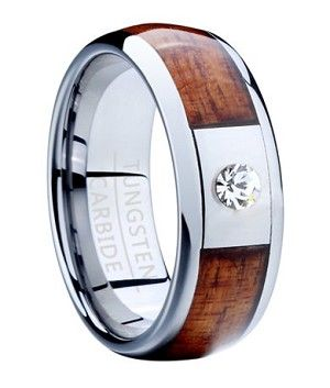 It doesn't get any more eye-catching than this men's tungsten ring with Koa wood inlay. Perfect as a contemporary wedding band or fashion ring, this domed 8mm comfort fit men's ring has an exotic Koa wood inlay bordered by polished rounded edges. A centerpiece of a single sparkling white cubic zirconia set in polished tungsten is a perfect final touch.