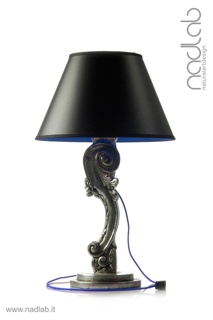 Bucefalo silver/blue /light OFF)  The base and the body of the lamp in wood are hand-carved.  The lampshade is made of PVC and coated in black chinette lined in blue lycra.  Decorated with silver leaf with worn effect.  Customizable on request.
