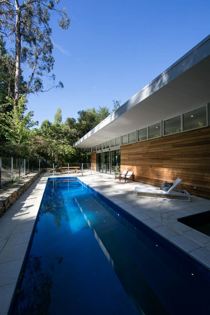 The back yard allows for a sense of secluded luxury. The exterior wall is clad in Blackbutt and sits alongside a 10metre lap pool.