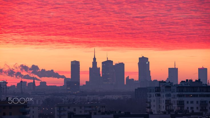 December morning over the roofs of the Warsaw - First rays of sun on the early December morning give this cityscape unique colors.