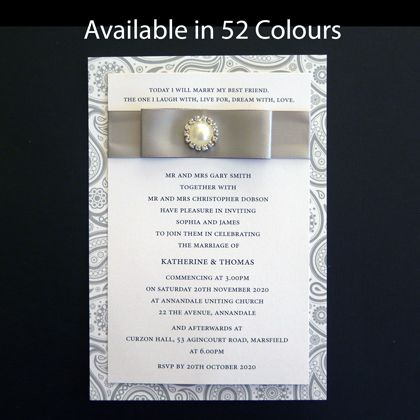 A wedding invitation with ribbon and a pearl and diamante embellishment. www.kardella.com