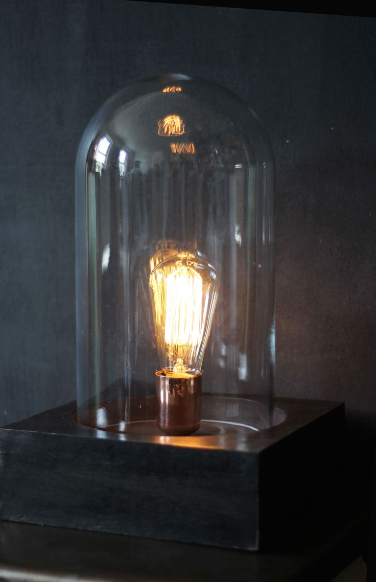 This bell jar side lamp is really unique - a beautiful copper base sits on a black wooden square stand, over which the large glass dome sits. http://www.aprilandthebear.com/lighting/bell-jar-table-light