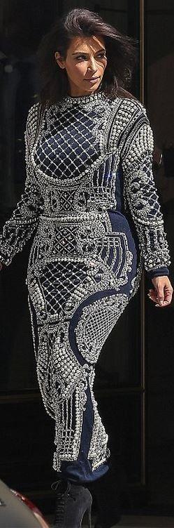 Kim Kardashian: Dress – Balmain  Shoes – Tom Ford