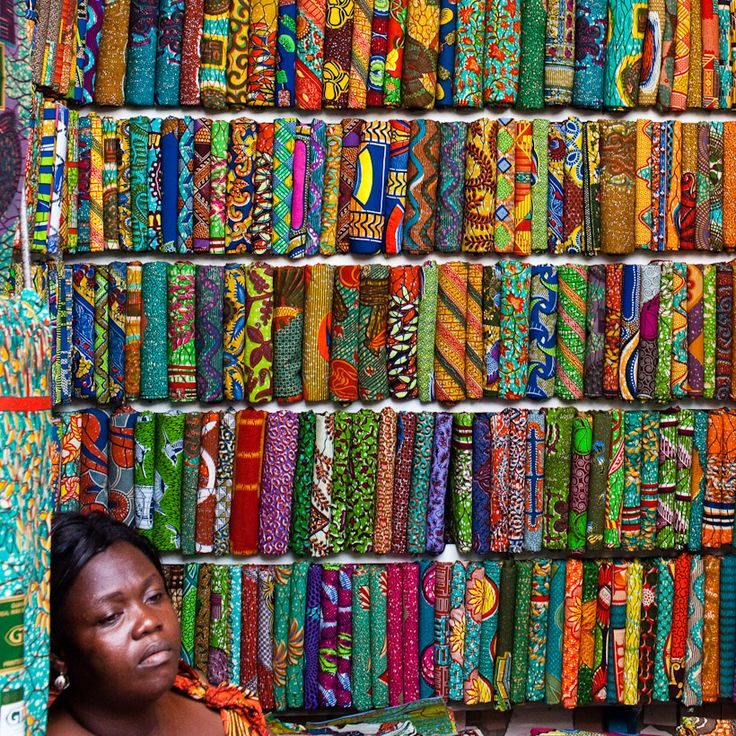Kente cloth is colorful woven fabric, historically worn by royalty in Ghana. Kente derives from the word kenten which means basket. Patterns in the cloth resemble the weave of a basket.  Kente cloth was expensive to own because of the quality of work put into the making. Today, people of all status wear the Kente cloth. Kente cloth is more than mere clothing; it is worn on special occasions such as weddings and important affairs.