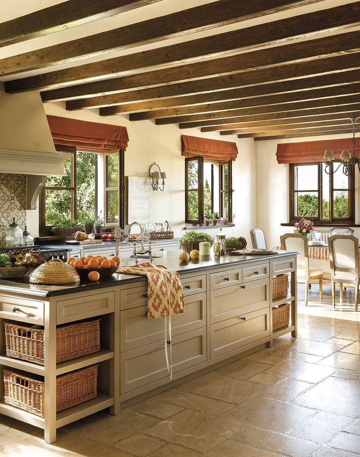 Beautiful kitchen, open beams, stone floor, stucco walls...