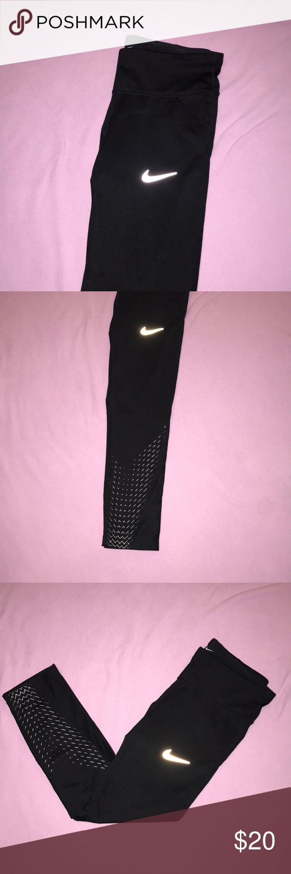NWOT Nike dri fit spandex capris Nike Never worn Dri fit spandex capris Black with silver reflective design on it No cracks in the reflective material Zipper pocket on the back Drawstring Mesh material on the back of the knees and bottom front of the capris  Size small No flaws  Bundle and save. Prices are always negotiable 💜💙  53 Nike Pants Track Pants & Joggers