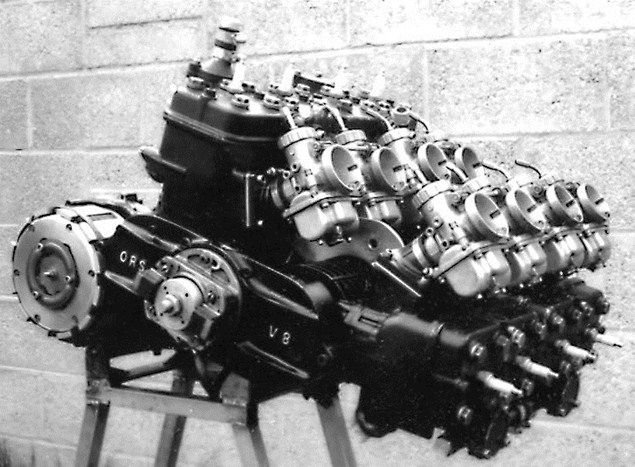 1.5litre V8 two-stroke (TZ 750 based). Looks like two integrated 4-cylinder mono-blocks to me. In which case absolute synchronicity is imperative.