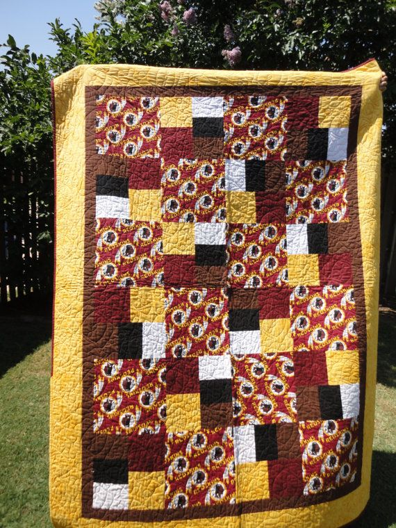 NFL Lap Quilt - Choose Your Team   ... WHA!!??!!  I know someone who needs this in KU... hmm...