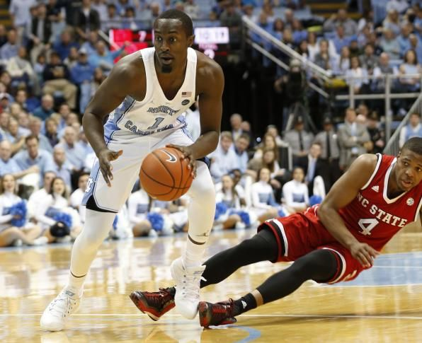 orth Carolina forward Theo Pinson (1) moves the ball upcourt against North Carolina State guard Dennis Smith Jr., right, during the first half of an NCAA college basketball game Sunday, Jan. 8, 2017, in Chapel Hill, N.C.