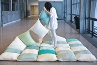 """Love this idea for a beach wedding. Instead of renting chairs... string pillows together to make a blanket quilt for guests to sit on in the sand. Also instead of using pillow cases for color, dye them with different colored fabric dye to match your wedding colors. Simple and cute"""" data-componentType=""""MODAL_PIN"""