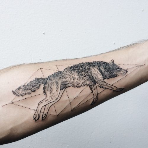 Running wolf on the forearm by Pony Reinhardt of Tenderfoot Studio in Portland, OR.