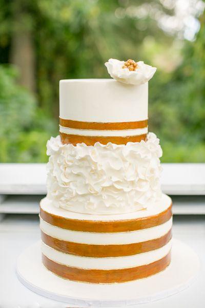 Gold and white wedding cake.