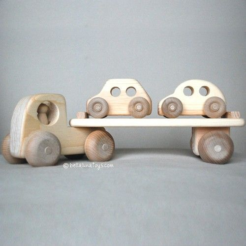 This handcrafted Car Carrier Wooden Toy Truck is made of thick native Maine white pine. Truck body connects to cab with a sturdy wooden peg, and cab has a removable driver. Truck length is approximate                                                                                                                                                                                 More