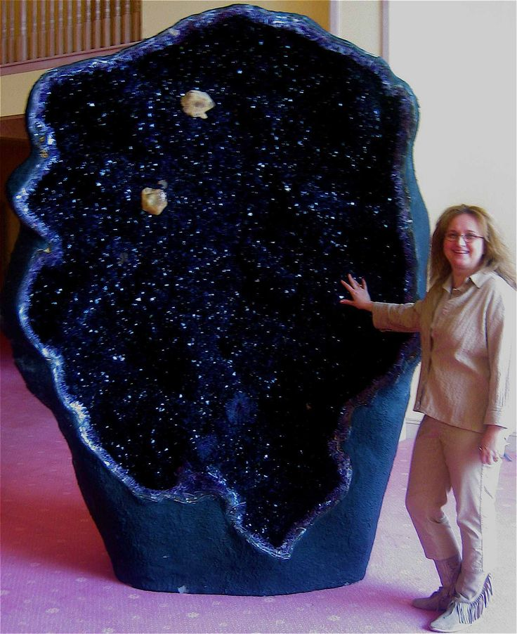 Cooooool! One of the world's largest amethyst geodes, the Empress of Uruguay, is located in Australia's Crystal Caves. It stands an alarming eleven feet tall and is filled with magnificent, deep violet crystals.