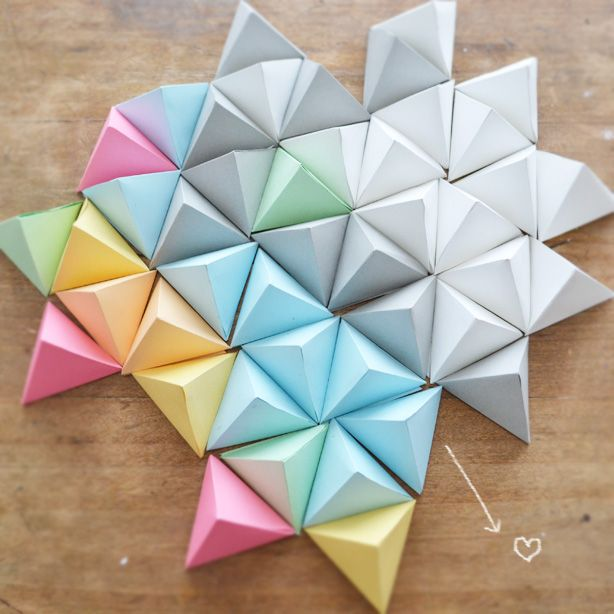 "paper pyramids -with a piece of tissue paper glued along the last seam that says ""take me"" or ""open me"" these would be perfect"