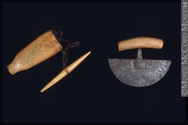 """This is a small ulu, or """"woman's knife."""" Ulus of this size were used for the intricate cutting required during clothing construction, one of the most important responsibilities of Inuit women. Larger ulus were used for slicing meat or trimming large skins. Little girls were given a tiny ulu so they could learn sewing skills. 1900-1909"""