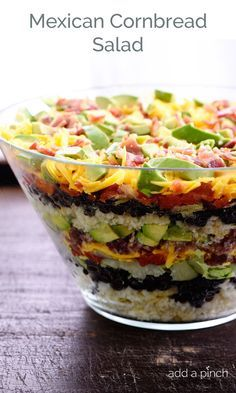 Mexican Cornbread Salad makes a delicious layered salad recipe using cornbread, beans, tomatoes, and so much more!