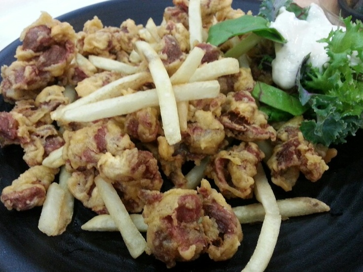 Fried chickens gizzard with potato. It is capital accompaniment of drinks.