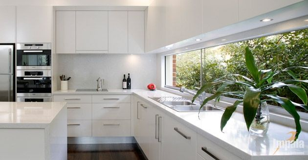 white overhead cupboards, wall mounted ovens