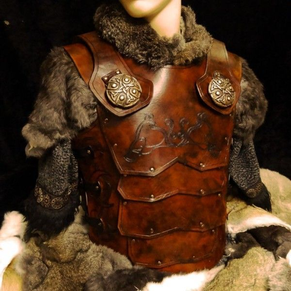 showing placement of brass lions on chest armor.