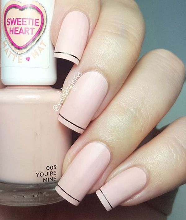 Baby pink and white French tips. Paint your nails in matte baby pink polish and simply paint a thin layer of white French tips. Add a small lining of black polish in between to distinguish the tip from the body.