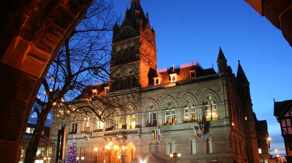 A shot of Chester Town Hall at dusk from the Chester Cathedral arch.