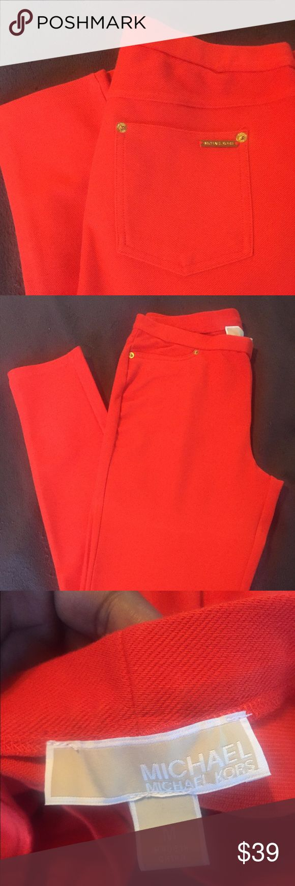 Michael Kors leggings Orange with gold buttons and a Michael Kors gold plate on back pocket. Very comfortable and stretch is awesome.Gently used just once Michael Kors Pants Leggings