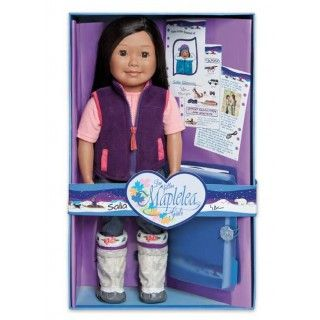 Saila's outfit blends contemporary style with her proud Inuit heritage. Her gathered neck t-shirt with an embroidered maple leaf gets an added layer of warmth from the zip-up vest.  Her dark silver jeans have a subtle sparkle so that they glisten like new-fallen snow.  On her feet she has traditional kamiik.  This premium quality doll is 46cm (18 inches) tall with a soft, huggable body and posable arms and legs. Her eyes open and close.