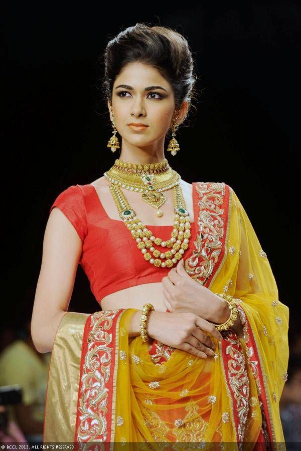 A model walks the ramp to showcase a creation by jewellery brand Laxmi Jewels during the India International Jewellery Week (IIJW), held at Grand Hyatt, Mumbai, on August 07, 2013