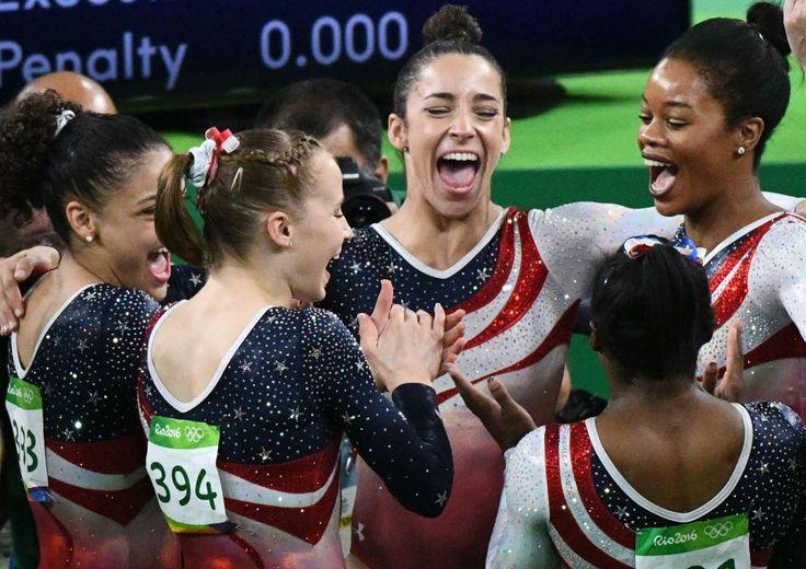 Gymnastics at the Rio Olympics - Team USA celebrates during the women's team…