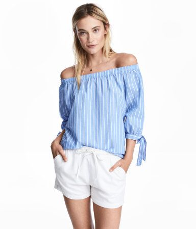 Light blue/striped. Wide-cut, off-the-shoulder blouse in woven cotton fabric with elastication at upper edge. 3/4-length raglan sleeves with narrow cuffs