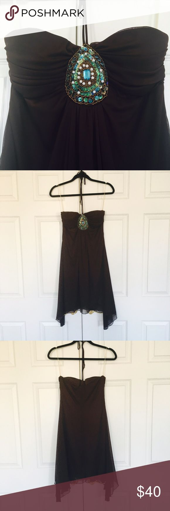 Sequin Sleeveless Dress Beautiful brown sequin dress perfect for all occasions! The material is flowy with a dark lining. B Darlin Dresses