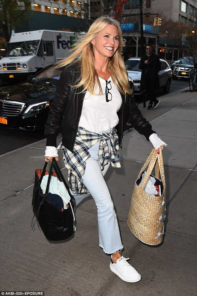 Stateside again: Christie Brinkley was spotted in New York City on Monday, lugging her bags about post-vacation