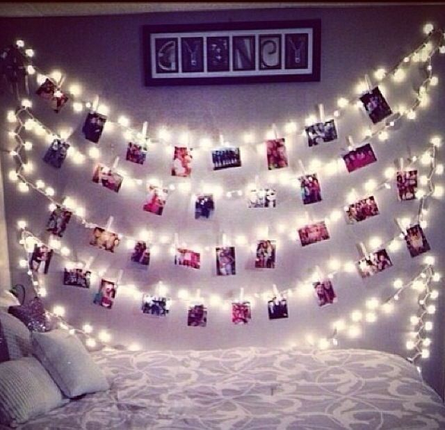 Polaroid pictures hanging from fairy lights by pegs for Bedroom ideas hanging pictures